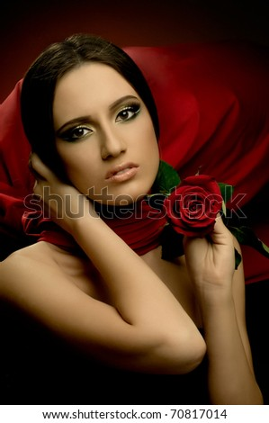 the very  pretty young woman with red neckerchief, with rose, sensual sexuality gaze...