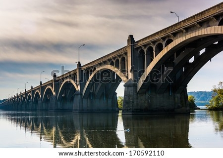 The Veterans Memorial Bridge reflecting in the Susquehanna River, in Columbia, Pennsylvania. - stock photo