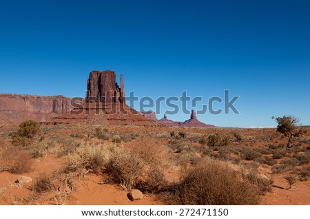 The vibrant landscape of Monument Valley in the American Southwest against a blue sky. - stock photo