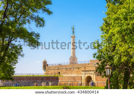 The Victor Monument at Kalemegdan, through the trees. - stock photo