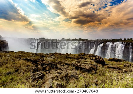 The Victoria falls is the largest curtain of water in the world (1708 meters wide). The falls and the surrounding area is the National Parks and World Heritage Site - Zambia, Zimbabwe  - stock photo