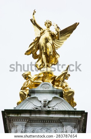 The Victoria memorial is a monument to Queen Victoria, located at the end of The Mall in London, and designed and executed by the sculptor Sir Thomas Brock. - stock photo