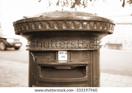 The victorian postbox in sepia scene represent the british postal style concept related idea. - stock photo