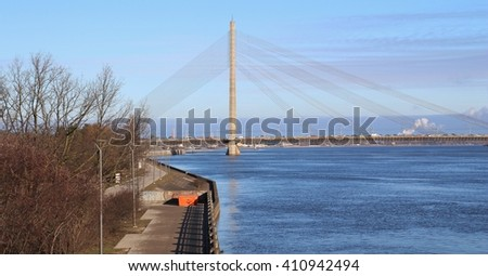 The view across the River Daugava to Vansu Bridge, Riga. Capital city of Latvia. - stock photo