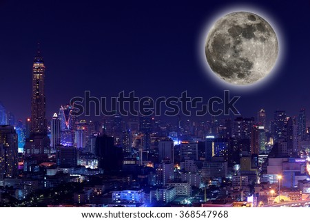 The View city at night with full moon.