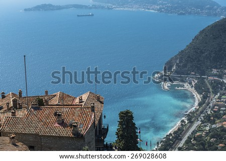 The view down to Eze-sur-Mer and the azure blue Mediterranean from the medieval Eze village - stock photo