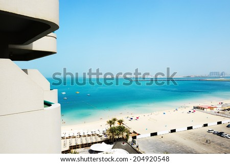 The view from balcony on beach and Jumeirah Palm man-made island, Dubai, UAE - stock photo