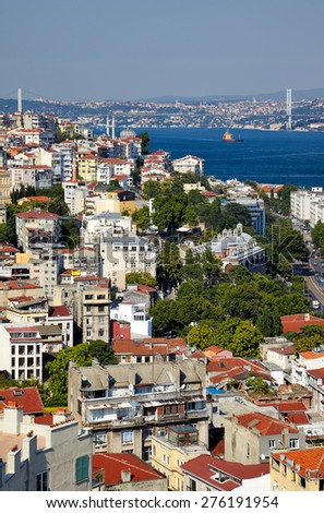 The view from Galata Tower to the residental  houses with Bosphorus Strait and Bridge in the background, Istanbul, Turkey - stock photo