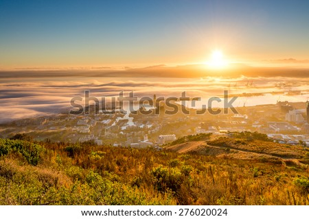 The view from Signal Hill just after sunrise, looking towards the V&A Waterfront, docks and the distant Durbanville Hills. - stock photo