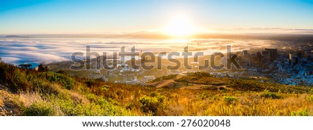 The view from Signal Hill just after sunrise, looking towards the V&A Waterfront, docks and the distant Durbanville Hills.The Stadium can be seen on the left, and city centre on the right. - stock photo