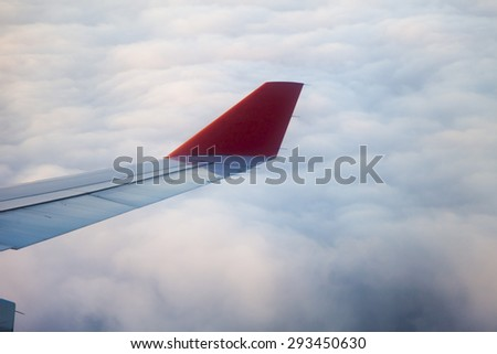 The view from the airplane window at the clouds and the heavens - stock photo