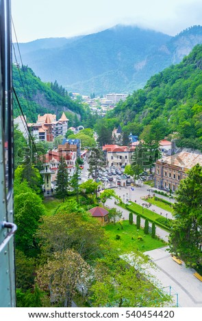 The view from the cable car, riding from Plateau station, on the mineral water park and the buildings of Borjomi old town, Georgia.