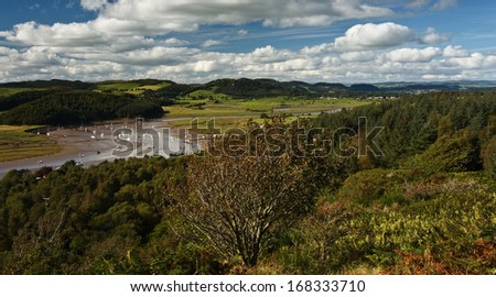 The view from the Muckle at Kippford or Scaur, Urr Water and yachts at the Quay can be seen in the bottom of the valley and in the distance Dalbeattie, Dumfries and Galloway. - stock photo