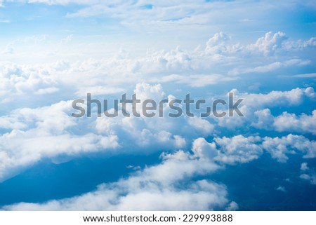 The View from the plane window above the cloud and blue sky - stock photo