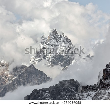 The view from the Renjo Pass (5360 m) on the Dudh Pokhari lake and the village of Gokyo - Nepal, Himalayas - stock photo