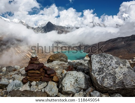 The view from the Renjo Pass (5360 m) on the lake Dudh Pokhari and the village of Gokyo - Nepal, Himalayas - stock photo