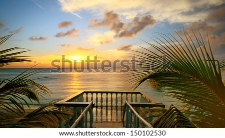 The view from the terraces of the beautiful sunset on the beach - stock photo