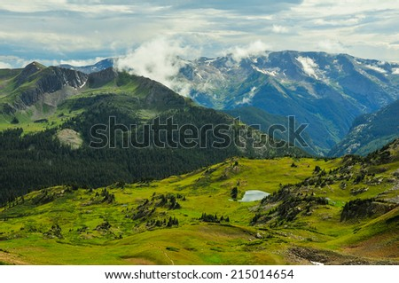 The view from Trail Rider Pass looking toward Treasure Mountain, Maroon Bells - Snowmass Wilderness - stock photo