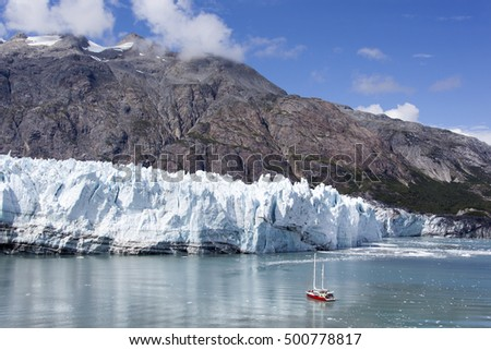 The view of a little boat by the glacier in Glacier Bay national park (Alaska).