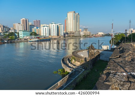 The view of Fort Santiago and buildings along the Pasay River, Intramuros, Manila, The Philippines.  - stock photo