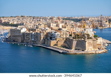 The view of Grand Harbour and Senglea (L-isla) peninsula  with  Fort Saint Michael on the tip from the bordering terrace of the Upper Barrakka Gardens. Malta