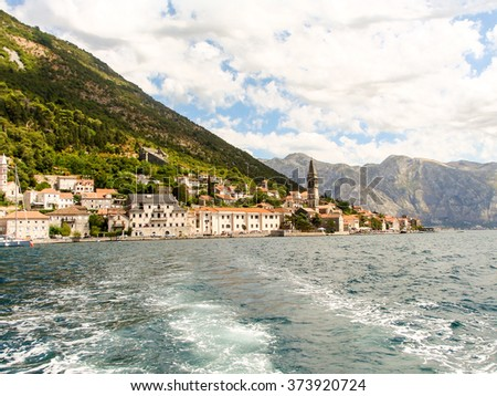 The view of Perast village near Kotor, Montenegro, from the Bay of Kotor. - stock photo