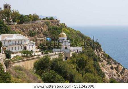 The view of sea coast in Sevastopol, Ukraine with the orthodox monastery on it - stock photo