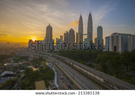 The view of sunrise over Kuala Lumpur city centre in the morning.  - stock photo