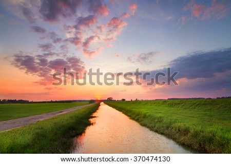 The view of sunset by the river. - stock photo