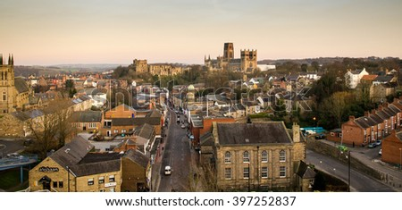 The view of the city of Durham, including the castle and cathedral, from the railway viaduct at sunset.