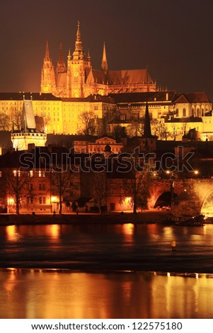 The View on colorful Prague gothic Castle with Charles Bridge in the Night, Czech Republic