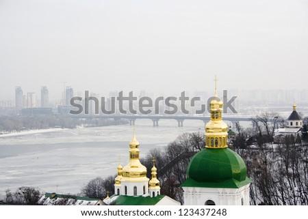 The view on Kiev Pechersk Lavra in winter time, Kyiv landscape. - stock photo