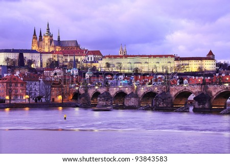 The View on Prague gothic Castle with Charles Bridge after Sunset, Czech Republic - stock photo