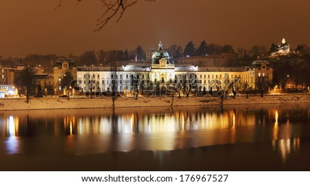 The View on the night snowy  Prague Office of Government above River Vltava