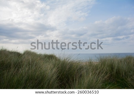 The view on the ocean and the beach at wild atlantic way from behind the dunes,  Republic of Ireland