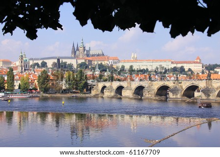The View on the summer Prague gothic Castle with the Charles Bridge