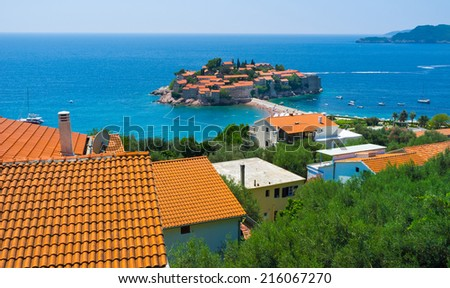 The view on the Sveti Stefan islet, that is the most beautiful resort of the Budva riviera, Montenegro. - stock photo