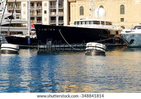 The view on Vittoriosa and modern yachts in sunset, Malta