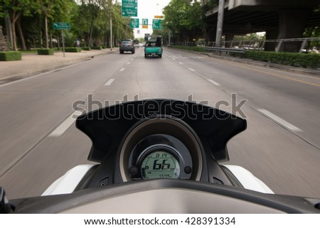 The view over the handlebars of motorcycle. Motorcycle rider - stock photo