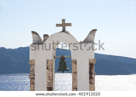 The views of the Aegean sea with white chapel with a bellin the foreground on Santorini island in Greece