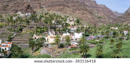 The village El Guro on the mountainside of the Valle Gran Rey on La Gomera. The small village is situated on the west side. El Guro is home of lots of artists who spend their life on the island - stock photo
