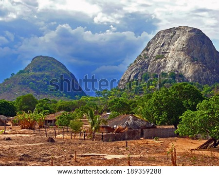 The village is in the mountains. Fabulously beautiful landscape. Africa, Mozambique. - stock photo