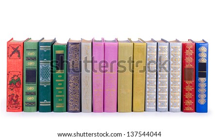 The vintage books in a row, isolated on white background - stock photo