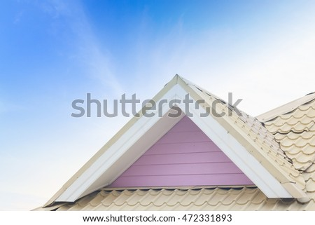 The vintage house with a roof with blue sky background.