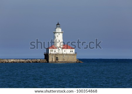 The vintage lighthouse at the entrance to the harbor in Chicago on Lake Michigan