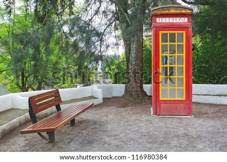 The vintage phone booth cabin in the park. - stock photo