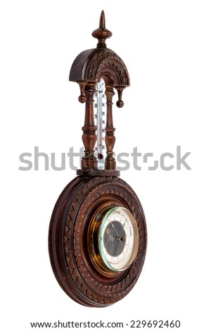 The vintage wooden barometer isolated on white background