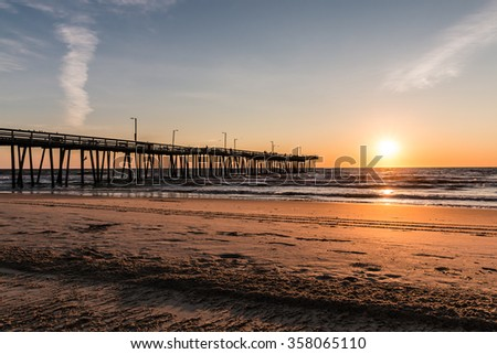 The Virginia Beach boardwalk fishing pier at dawn. - stock photo