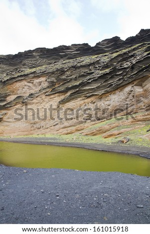 The volcanic lake - El Golfo, Lanzarote, Canary Islands, Spain - stock photo