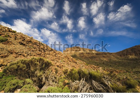The volcanic landscape and sky in the Teide National Park. Tenerife, Spain - stock photo